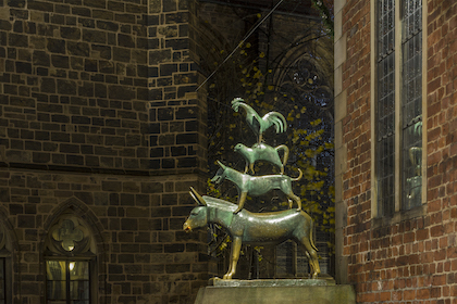 The sculpture of the Bremen town musicians by night. Central square of Bremen